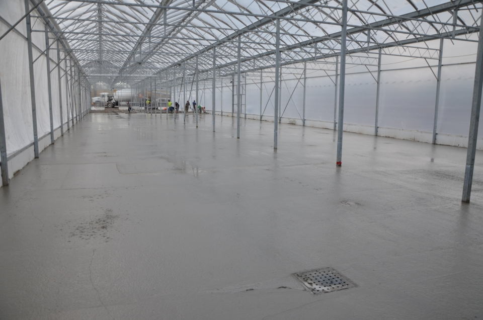 Pouring the floor of the new VPL greenhouse.